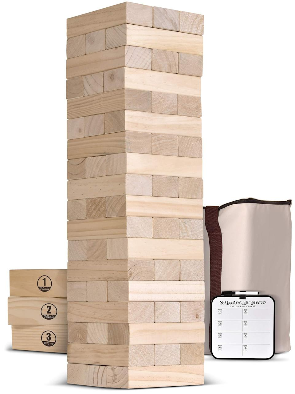"<h3><a href=""https://amzn.to/3948WgM"" rel=""nofollow noopener"" target=""_blank"" data-ylk=""slk:GoSports Wooden Toppling Tower"" class=""link rapid-noclick-resp"">GoSports Wooden Toppling Tower</a></h3> <br>This five-foot twist on a childhood classic packs up seamlessly in a convenient carrying case so you can take your game on-the-go to the beach, the BBQ, the park, and beyond. <br><br><strong>GoSports</strong> Wooden Toppling Tower, $, available at <a href=""https://amzn.to/2WoRXRn"" rel=""nofollow noopener"" target=""_blank"" data-ylk=""slk:Amazon"" class=""link rapid-noclick-resp"">Amazon</a><br>"