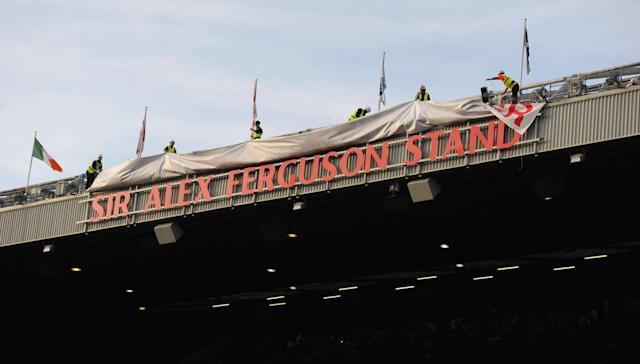 MANCHESTER, ENGLAND - NOVEMBER 05: Workmen reveal the sign for the Sir Alex Ferguson Stand during the Barclays Premier League match between Manchester United and Sunderland at Old Trafford on November 5, 2011 in Manchester, England. (Photo by Michael Regan/Getty Images)