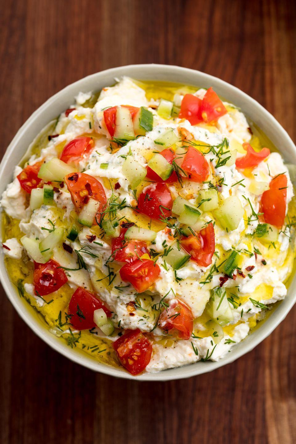 """<p>We love a dip, and this feta dip is seriously tasty.</p><p>Get the <a href=""""https://www.delish.com/uk/cooking/recipes/a32386044/greek-feta-dip-recipe/"""" rel=""""nofollow noopener"""" target=""""_blank"""" data-ylk=""""slk:Whipped Feta Dip"""" class=""""link rapid-noclick-resp"""">Whipped Feta Dip</a> recipe. </p>"""