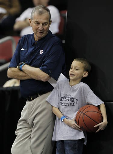 Connecticut head coach Jim Calhoun talks with his grandson Sam during basketball practice in Louisville, Ky., Wednesday, March 14, 2012. Connecticut is scheduled to play Iowa State in an NCAA tournament second-round college basketball game on Thursday.(AP Photo/John Bazemore)