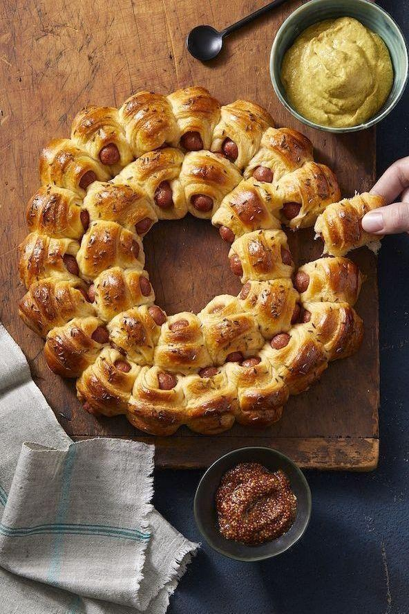 "<p>This pull-apart pigs in a blanket recipe, using cocktail franks and crescent roll dough, takes your childhood favorite to the next level.</p><p><em><strong>Get the recipe at <a href=""https://www.goodhousekeeping.com/food-recipes/a11579/easy-pigs-in-a-blanket-recipe-122799/"" rel=""nofollow noopener"" target=""_blank"" data-ylk=""slk:Good Housekeeping."" class=""link rapid-noclick-resp"">Good Housekeeping.</a></strong></em></p>"