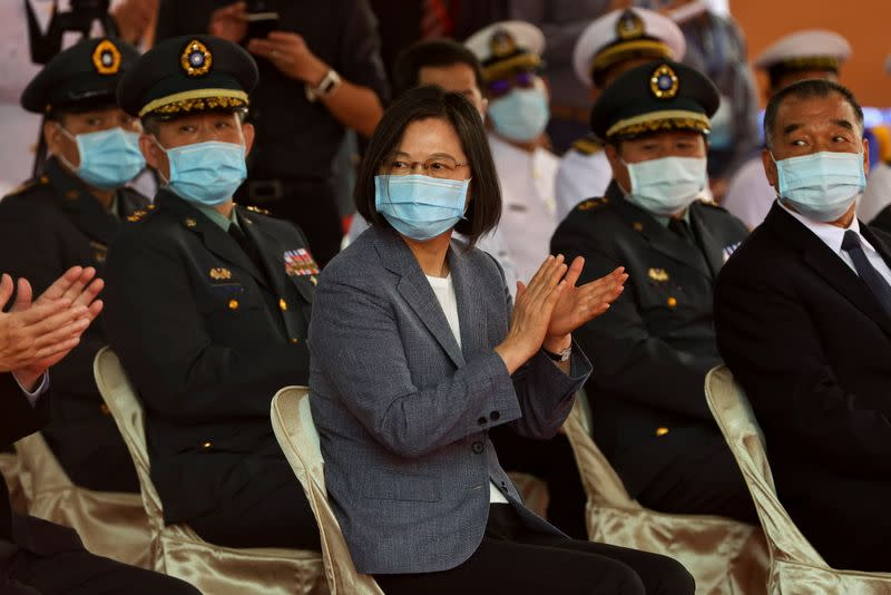 "Taiwan's President Tsai Ing-wen applauds during the launch ceremony for Taiwan Navy's domestically built amphibious transport dock ""Yushan"" in Kaohsiung"