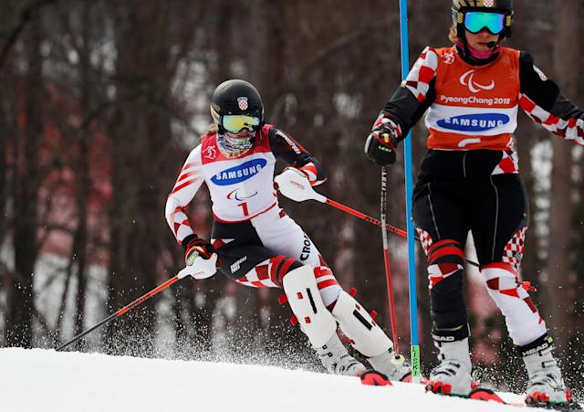 Alpine Skiing - Pyeongchang 2018 Winter Paralympics - Women's Slalom - Visually Impaired - Run 2 - Jeongseon Alpine Centre - Jeongseon, South Korea - March 18, 2018 - Eva Goluza of Croatia and her guide. REUTERS/Paul Hanna