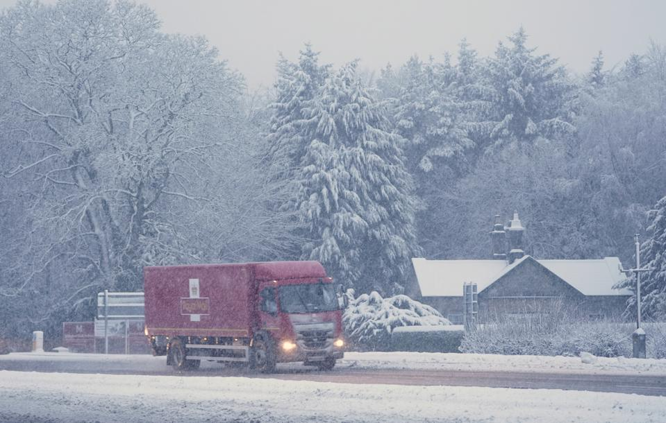 A Royal Mail lorry drives through snow on the A69 near Newcastle. Heavy snow and freezing rain is set to batter the UK this week, with warnings issued over potential power cuts and travel delays. (Photo by Owen Humphreys/PA Images via Getty Images)