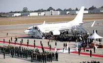 Friends and family members arrive with the body of former Zimbabwean President Robert Mugabe to the country after he died in Singapore, in Harare