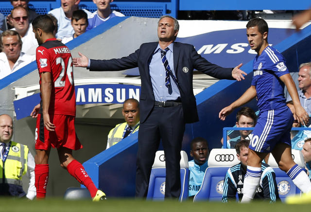 Chelsea's manager Jose Mourinho, center, gestures as he watches his team play against Leicester City during their English Premier League soccer match at Stamford Bridge, London, Saturday, Aug. 23, 2014. (AP Photo/Sang Tan)