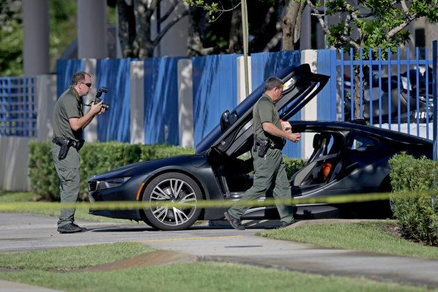 A BMW sits idle after reports of a shooting in Deerfield Beach involving Broward rapper XXXTentacion on Monday, June 18, 2018. The celebrity news site TMZ reports that the 20-year-old XXXTentacion, given name Jahseh Onfroy, was shopping for a motorcycle when a gunman ran up to his vehicle and shot him. (John McCall/South Florida Sun Sentinel/TNS via Getty Images)