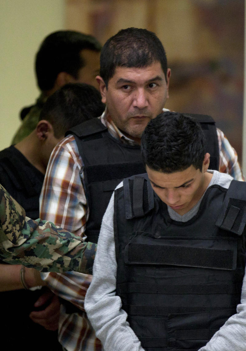 "The alleged leader of a faction of the hyper-violent Zetas cartel, Ivan Velazquez Caballero, known as ""El Taliban,""  is escorted to a media presentation at the Mexican Navy's Center for Advanced Naval Studies in Mexico City,Thursday, Sept. 27, 2012. Velazquez Caballero allegedly has been fighting a bloody internal battle with top Zetas' leader Miguel Angel Trevino Morales, and officials have said the split was behind a recent surge in massacres and shootouts, particularly in northern Mexico. (AP Photo/Eduardo Verdugo)"
