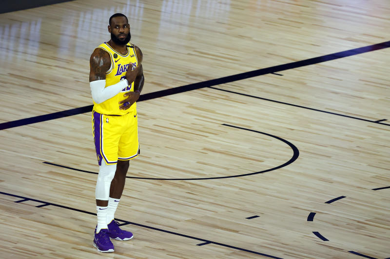 LeBron James stands alone on a basketball court.