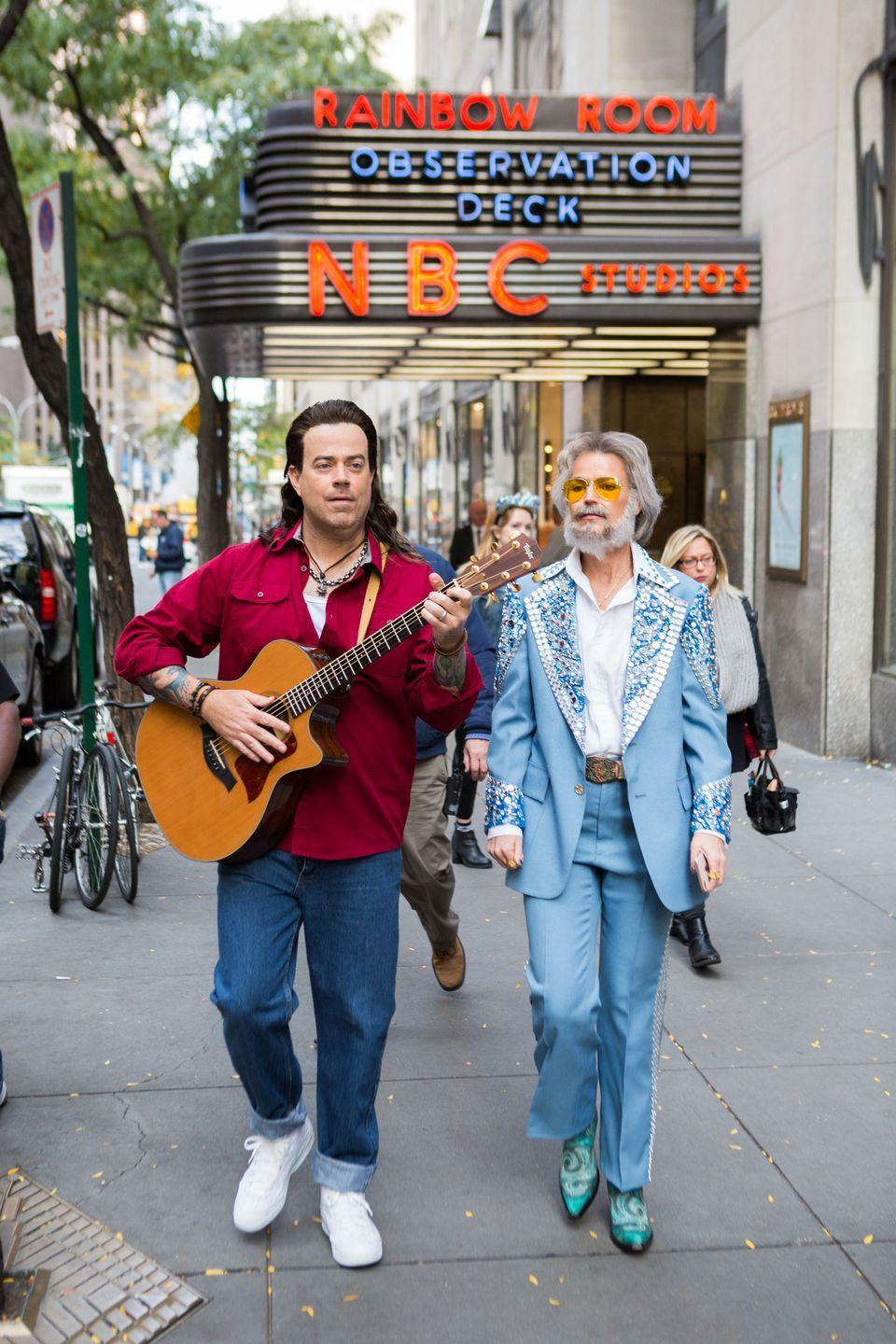 "<p>With a securely fastened mullet, Carson Daly carried the quintessential guitar prop that can only mean he dressed up as the ""Achy Breaky Heart"" singer Billy Ray Cyrus. And he wasn't the only one with some extra hair that year! Savannah Guthrie had a little fuzz on her face while channeling Kenny Rogers. </p>"