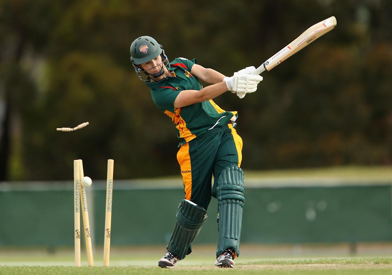 LAUNCESTON, AUSTRALIA - OCTOBER 25:  Linsey Da Costa of Tasmania is bowled by Ellyse Perry of New South Wales during the WT20 match between Tasmania and New South Wales at the NTCA Ground on October 25, 2013 in Launceston, Australia.  (Photo by Robert Prezioso/Getty Images)