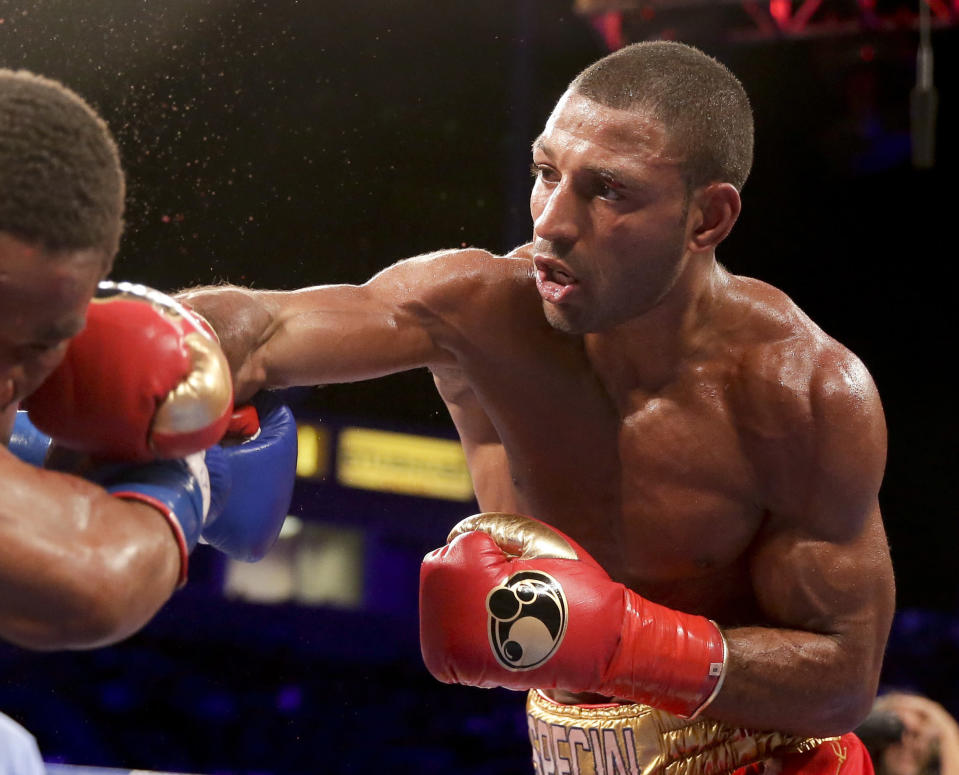 FILE - In this Aug. 16, 2014, file photo, Kell Brook, right, hits Shawn Porter during their IBF welterweight title boxing bout in Carson, Calif. Brook, who fought at 160 pounds when he was stopped in the fifth round by Golovkin in 2016, said he started losing weight early for this fight so he wouldn't have to starve himself late. But there are questions not only about him coming down in weight but also the wear and tear he's had in his years in the ring. At the age of 34, it could be his final hurrah if he can't come up with the performance of a lifetime against Crawford. (AP Photo/Chris Carlson, File)