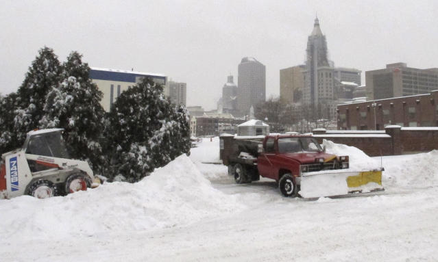 Crews clear snow as ice pellets fall Wednesday, Feb. 5, 2014 in Hartford, Conn. A winter storm was expected to dump up to 10 inches of snow and sleet in parts of the state. (AP Photo/Dave Collins)