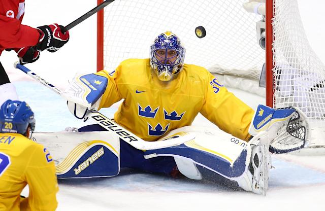 SOCHI, RUSSIA - FEBRUARY 23: Henrik Lundqvist #30 of Sweden makes a save during the Men's Ice Hockey Gold Medal match against Canada on Day 16 of the 2014 Sochi Winter Olympics at Bolshoy Ice Dome on February 23, 2014 in Sochi, Russia. (Photo by Streeter Lecka/Getty Images)