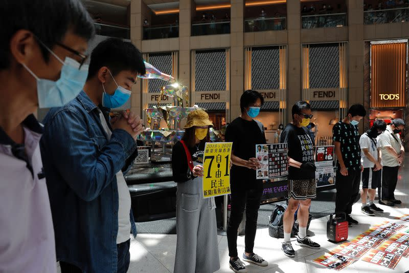 Pro-democracy protesters observe a minute of silence during a protest after China's parliament passes a national security law for Hong Kong