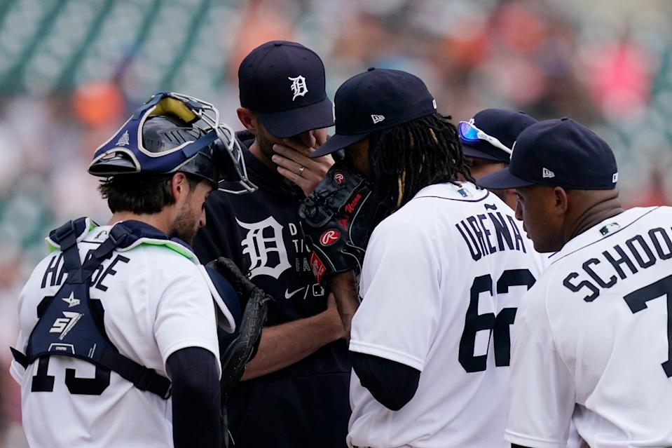 Detroit Tigers pitching coach Chris Fetter talks with starting pitcher Jose Urena during the second inning of a baseball game against the Chicago White Sox, Saturday, June 12, 2021, in Detroit.