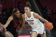 Connecticut's Olivia Nelson-Ododa (20) drives toward the basket as Houston's Tatyana Hill (30) defends during the second half of an NCAA college basketball game Saturday, Feb. 29, 2020, in Houston. Connecticut won 92-40. (AP Photo/David J. Phillip)