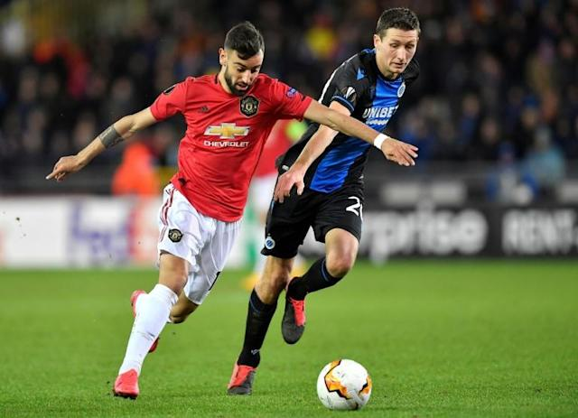 Bruno Fernandes (L) provided a spark off the bench in a brief cameo for United (AFP Photo/JOHN THYS)