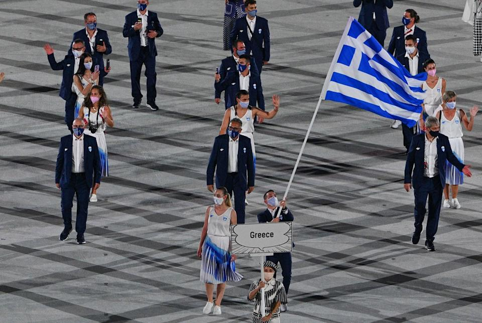 <p>Greece is always first since that's where the Games originated. Then the order followed the Japanese alphabet, with future Olympic host countries being last. </p>