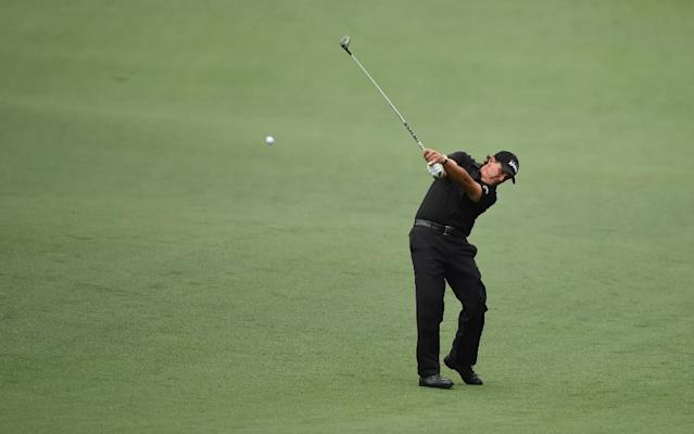 Phil Mickelson hits a shot on the 8th hole during Round 4 of the 79th Masters Golf Tournament at Augusta National Golf Club on April 12, 2015 (AFP Photo/Timothy A. Clary)