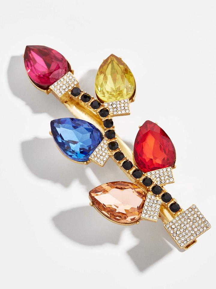 "<p><a href=""https://www.popsugar.com/buy/BaubleBar-Bulb-Hair-Barrette-510252?p_name=BaubleBar%20Bulb%20Hair%20Barrette&retailer=baublebar.com&pid=510252&price=24&evar1=fab%3Auk&evar9=46839727&evar98=https%3A%2F%2Fwww.popsugar.com%2Ffashion%2Fphoto-gallery%2F46839727%2Fimage%2F46839728%2FBaubleBar-Bulb-Hair-Barrette&list1=shopping%2Cjewelry%2Choliday%2Ccollections%2Cbaublebar%2Choliday%20fashion&prop13=api&pdata=1"" rel=""nofollow"" data-shoppable-link=""1"" target=""_blank"" class=""ga-track"" data-ga-category=""Related"" data-ga-label=""https://www.baublebar.com/product/48440-bulb-hair-barrette"" data-ga-action=""In-Line Links"">BaubleBar Bulb Hair Barrette</a> ($24)</p>"
