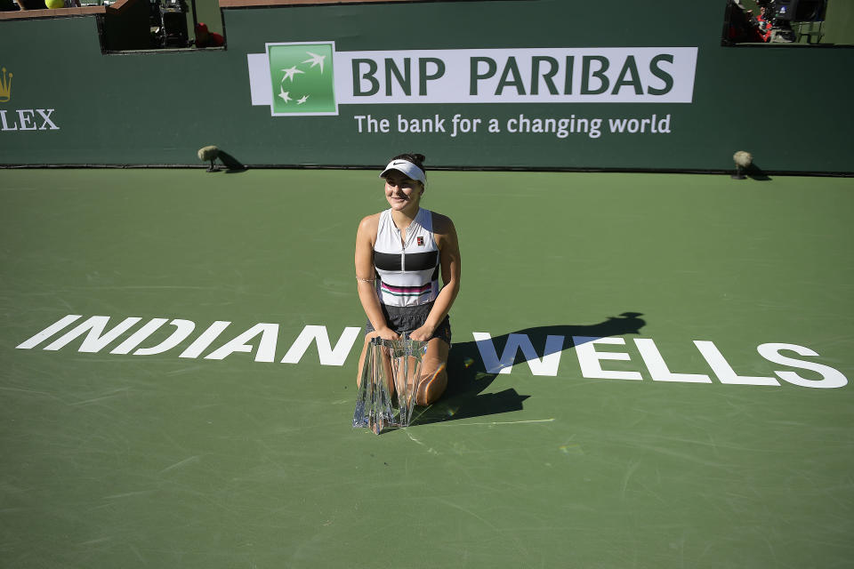 FILE - In this March 17, 2019, file photo, Bianca Andreescu, of Canada, poses with her trophy after defeating Angelique Kerber, of Germany, in the women's final at the BNP Paribas Open tennis tournament in Indian Wells, Calif. The BNP Paribas Open is returning to the Southern California desert this fall after being knocked out of its usual March dates this year and last because of the COVID-19 pandemic. (AP Photo/Mark J. Terrill, File)