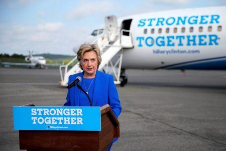 U.S. Democratic presidential candidate Hillary Clinton holds a news conference on the airport tarmac in front of her campaign plane in White Plains