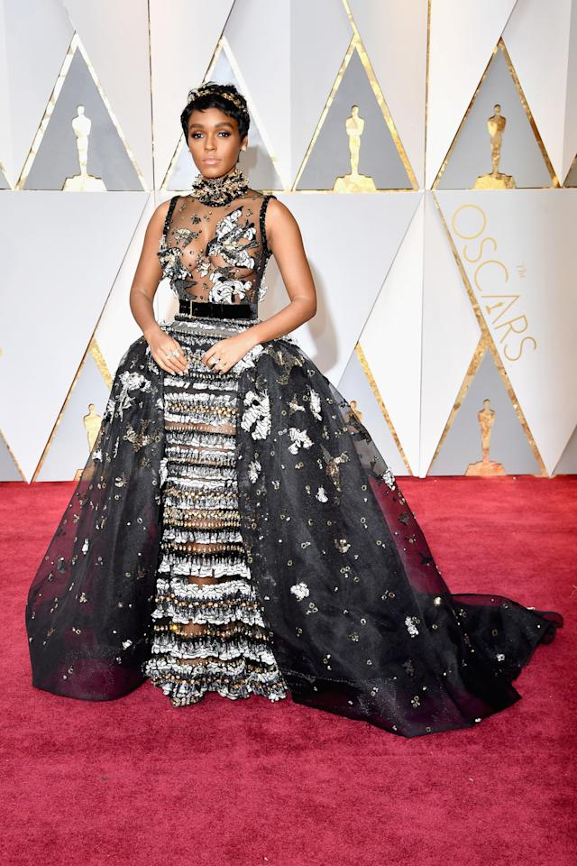 "<p><a rel=""nofollow"" href=""https://www.yahoo.com/style/janelle-monae-ups-her-back-and-white-game-for-the-oscars-red-carpet-012015007.html"">Janelle Monae</a> sticks with a black and white uniform. Yet for the 2017 Oscars, where<em> Moonlight</em> won for best picture, she added some gold to her overall look.<em> (Photo: Getty Images)</em> </p>"