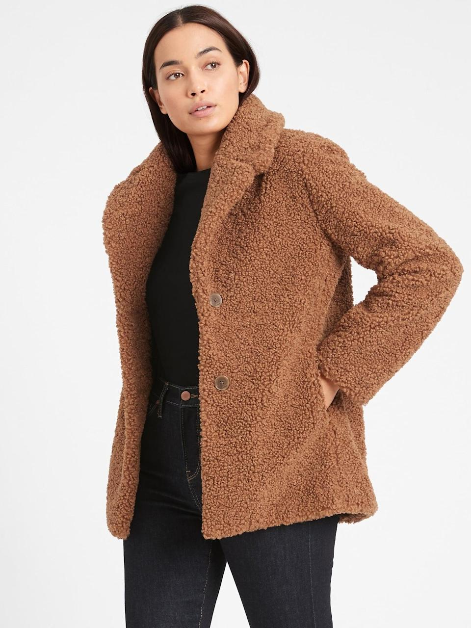 <p>Stay cozy in this <span>Sherpa Jacket</span> ($224, originally $249).</p>