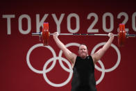 Laurel Hubbard of New Zealand competes in the women's +87kg weightlifting event at the 2020 Summer Olympics, Monday, Aug. 2, 2021, in Tokyo, Japan. (AP Photo/Luca Bruno)