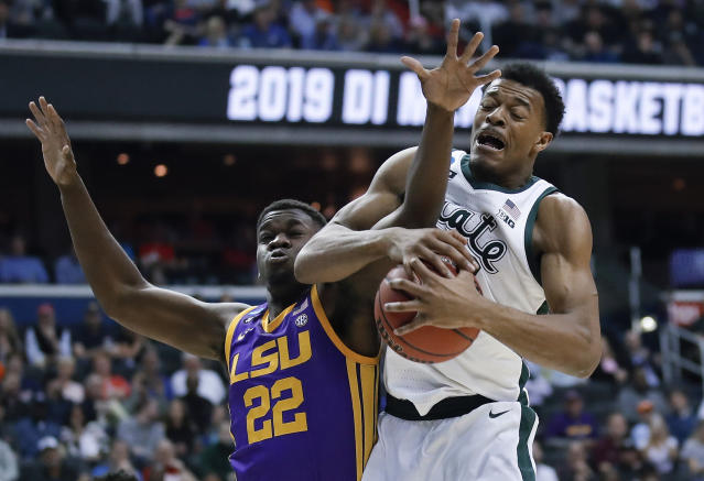 Michigan State forward Xavier Tillman (23) beats out LSU forward Darius Days (22) for the loose ball during the first half of an East Regional semifinal in the NCAA men's college basketball tournament Friday, March 29, 2019, in Washington. (AP Photo/Alex Brandon)