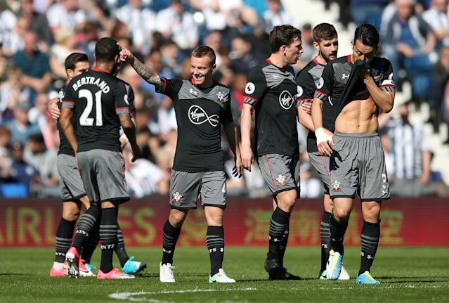 <p>Jordy Clasie celebrates his opening goal for Saints</p>