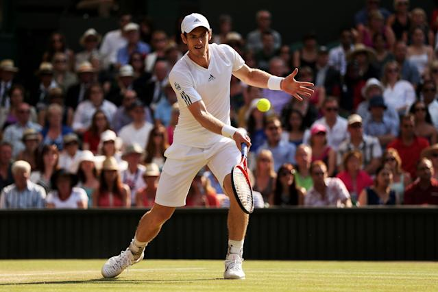 LONDON, ENGLAND - JULY 07: Andy Murray of Great Britain plays a forehand volley during the Gentlemen's Singles Final match against Novak Djokovic of Serbia on day thirteen of the Wimbledon Lawn Tennis Championships at the All England Lawn Tennis and Croquet Club on July 7, 2013 in London, England. (Photo by Clive Brunskill/Getty Images)