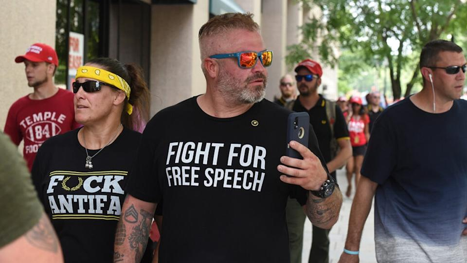 "Joe Biggs (center) leaves after participating in a ""Demand Free Speech"" rally on Freedom Plaza on July 6, 2019 in Washington, DC. (Photo by Stephanie Keith/Getty Images)"