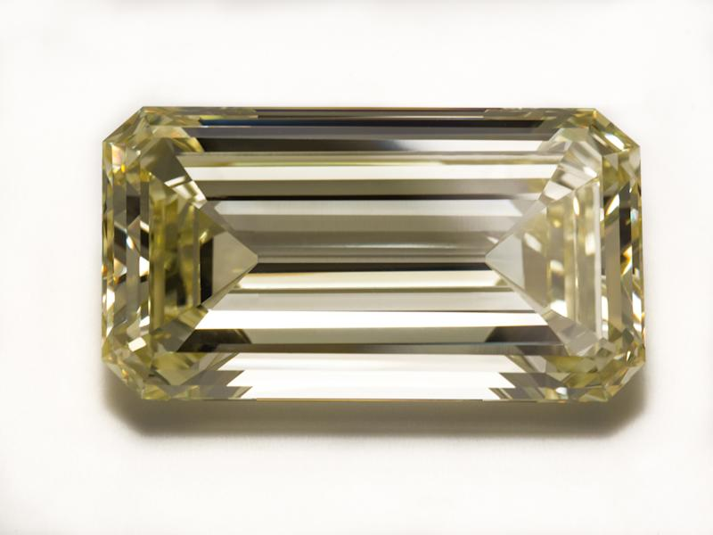 This undated photo provided by the American Museum of Natural History shows a rare 19th century 55.08-carat diamond has gone on temporary view at the museum in New York. The Kimberley Diamond gets its name from the mine in South Africa where it was found sometime before 1868. It was cut from a 490-carat crystal. The champagne-colored, emerald-cut diamond will be on display through the end of June 2014. (AP Photo/American Museum of Natural History, Denis Finnin)