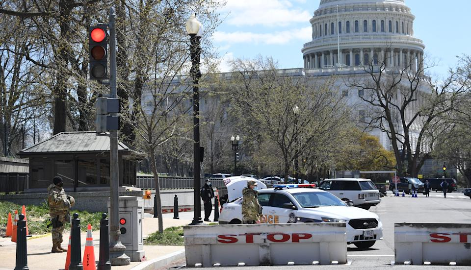 Police and members of the National Guard block a street near the US Capitol on April 2, 2021, after a vehicle drove into US Capitol police officers in Washington, DC. - Two police officers were injured near the US Capitol on Friday after being rammed by a vehicle whose driver was subsequently arrested, police said.
