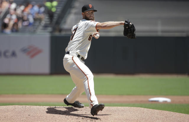 San Francisco Giants pitcher Conner Menez throws to a New York Mets batter during the first inning of a baseball game in San Francisco, Sunday, July 21, 2019. (AP Photo/Jeff Chiu)