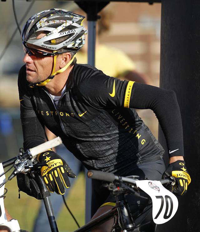 FILE - In this Aug. 25, 2012, file photo, cyclist Lance Armstrong prepares to take part in the Power of Four mountain bicycle race in Snowmass Village, Colo. U.S. Masters Swimming Executive Director Rob Butcher said Thursday, April 4, 2013, that Armstrong will not swim three distance events in the Masters South Central Zone Swimming Championships at the University of Texas this weekend after swimming's international federation body raised objections. (AP Photo/David Zalubowski, File)