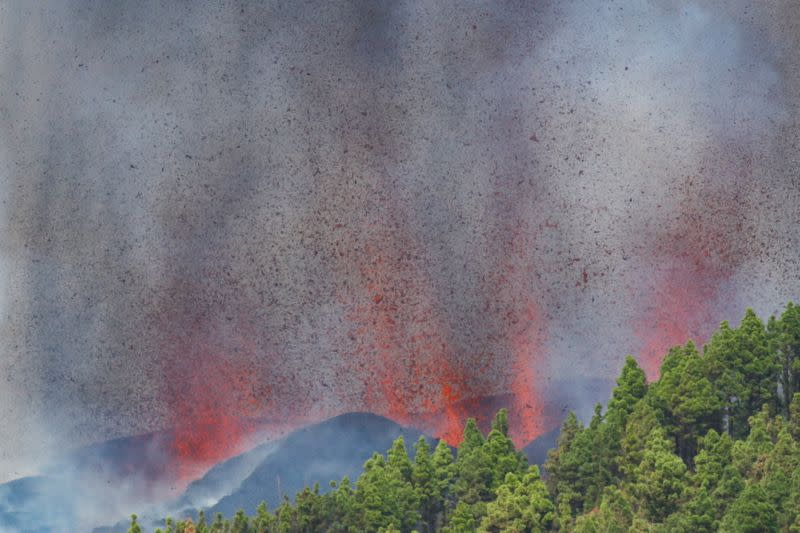 Lava and smoke rise following the eruption of a volcano in Spain