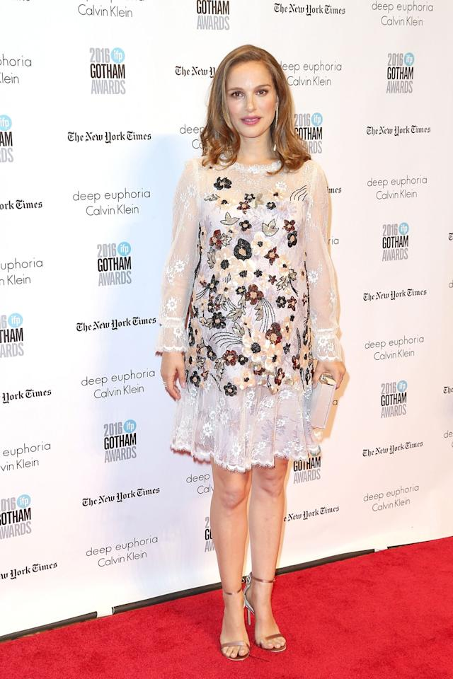 <p>The actress, who has been heavily promoting her upcoming film, <em>Jackie</em>, nailed pregnancy style in a lace, long-sleeved, floral embroidered dress, which featured detailed beading and sequins. Her gold-and-pearl jewelry from Tiffany & Co. were the perfect accessories to complement the show-stopping frock. (Photo: Getty Images) </p>