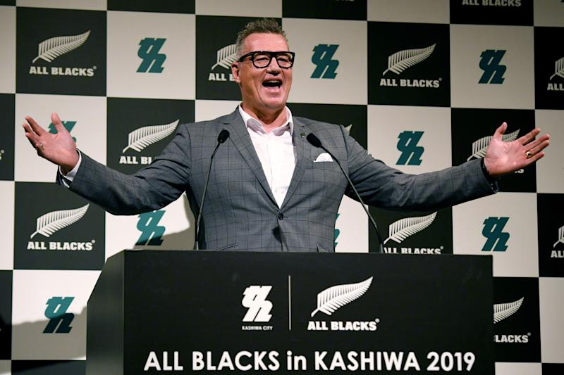 New Zealand's former rugby player John Kirwan smiles and delivers a speech.
