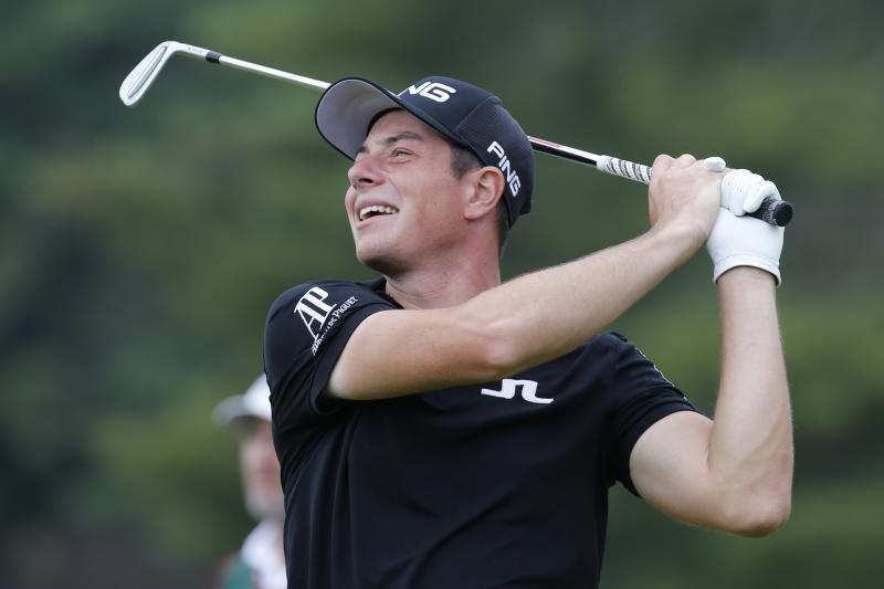 Viktor Hovland, of Norway, watches his tee shot on the 18th hole during the second round of A Military Tribute at The Greenbrier golf tournament in White Sulphur Springs, W.Va., Friday, Sept. 13, 2019. (AP Photo/Steve Helber)
