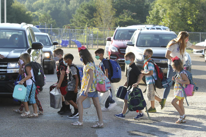 Saltillo Primary School students arrive for their first day of school Thursday in Saltillo, Miss. (Adam Robison/Northeast Mississippi Daily Journal via AP)