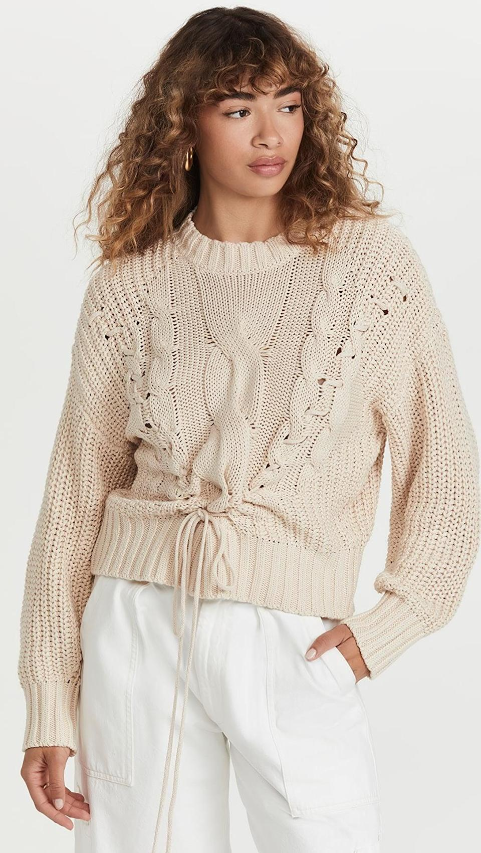 <p>It's fall, which means you need a new sweater. This <span>525 Cotton Cable Sweater with Lacing</span> ($138) is how you take a classic silhouette and give it a modern twist.</p>