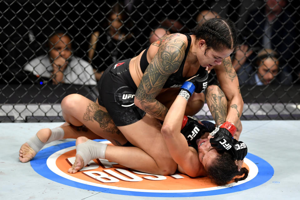 LAS VEGAS, NEVADA - DECEMBER 14:  Amanda Nunes of Brazil (top) strikes Germaine de Randamie of Netherlands in their UFC women's bantamweight championship bout during the UFC 245 event at T-Mobile Arena on December 14, 2019 in Las Vegas, Nevada. (Photo by Jeff Bottari/Zuffa LLC)