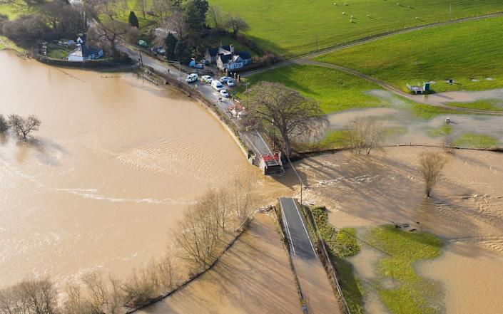 The historic Llanerch Bridge between Trefnant and Tremeirchion collapsed due to the floodwaters - Getty Images Europe