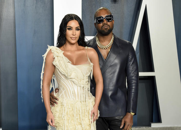 FILE -Kim Kardashian West, left, and Kanye West arrive at the Vanity Fair Oscar Party in Beverly Hills, Calif. on Feb. 9, 2020. Kim's first husband was music producer Damon Thomas, followed by a 72-day marriage to second husband, basketball player Kris Humphries, and a third trip to the altar with West. All three unions ended in divorce. (Photo by Evan Agostini/Invision/AP, File)