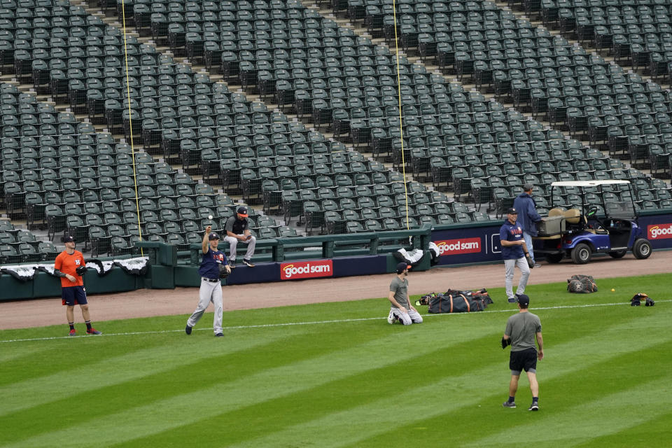 Members of the Houston Astros workout after Game 4 of an ALDS baseball game was postponed due to a forecast of inclement weather Monday, Oct. 11, 2021, in Chicago. The makeup game is scheduled for Tuesday afternoon at Guaranteed Rate Field. (AP Photo/Charles Rex Arbogast)