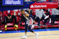 Washington Wizards' Russell Westbrook limps down the court after an injury during the second half of Game 2 in a first-round NBA basketball playoff series against the Philadelphia 76ers, Wednesday, May 26, 2021, in Philadelphia. (AP Photo/Matt Slocum)