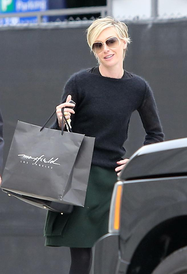 50972731 'Arrested Development' actress Portia de Rossi spends some cash in Beverly Hills, California on December 17th, 2012. FameFlynet, Inc - Beverly Hills, CA, USA -  1 (818) 307-4813
